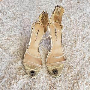 Bebe gold heels & clear straps